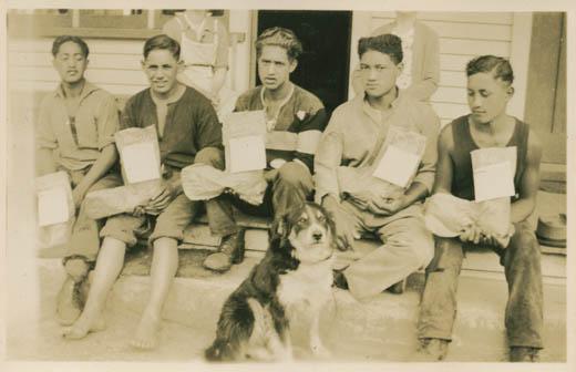 Boys from the Maori Boy's Farm at Te Whaiti with their Christmas stockings, Christmas morning, 1944.