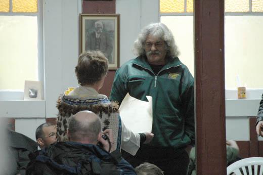 Very Rev. Pamela Tankersley hands back land deeds at Te Maungapohatu Marae in Te Urewara.